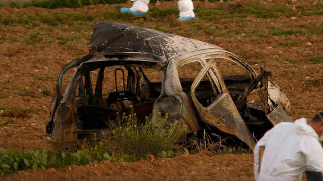 Journalisten ble drept av en bombe som var skjult under bilen hun kjørte.
