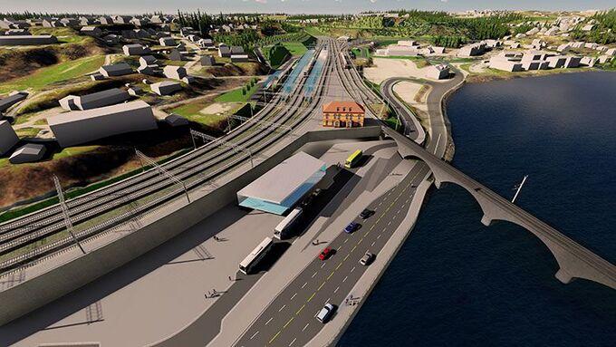 En del av prosjektet er å bygge nytt stasjonsområde i Hønefoss, her sett fra øst mot vest. Den gamle stasjonsbygningen ses oppe ved sporene, i gult.