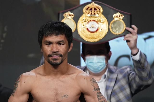 Den filippinske bokseren Manny Pacquiao fotografert foran en kamp i Las Vegas i fjor. Nå stiller han som presidentkandidat i Filippinene. Foto: John Locher / AP / NTB