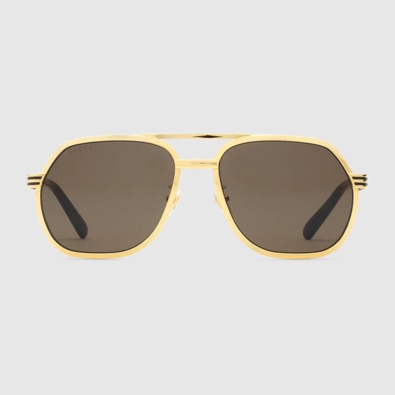 Solbriller med gullramme