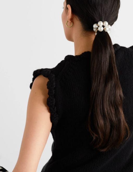 Store perler på hårstrikk