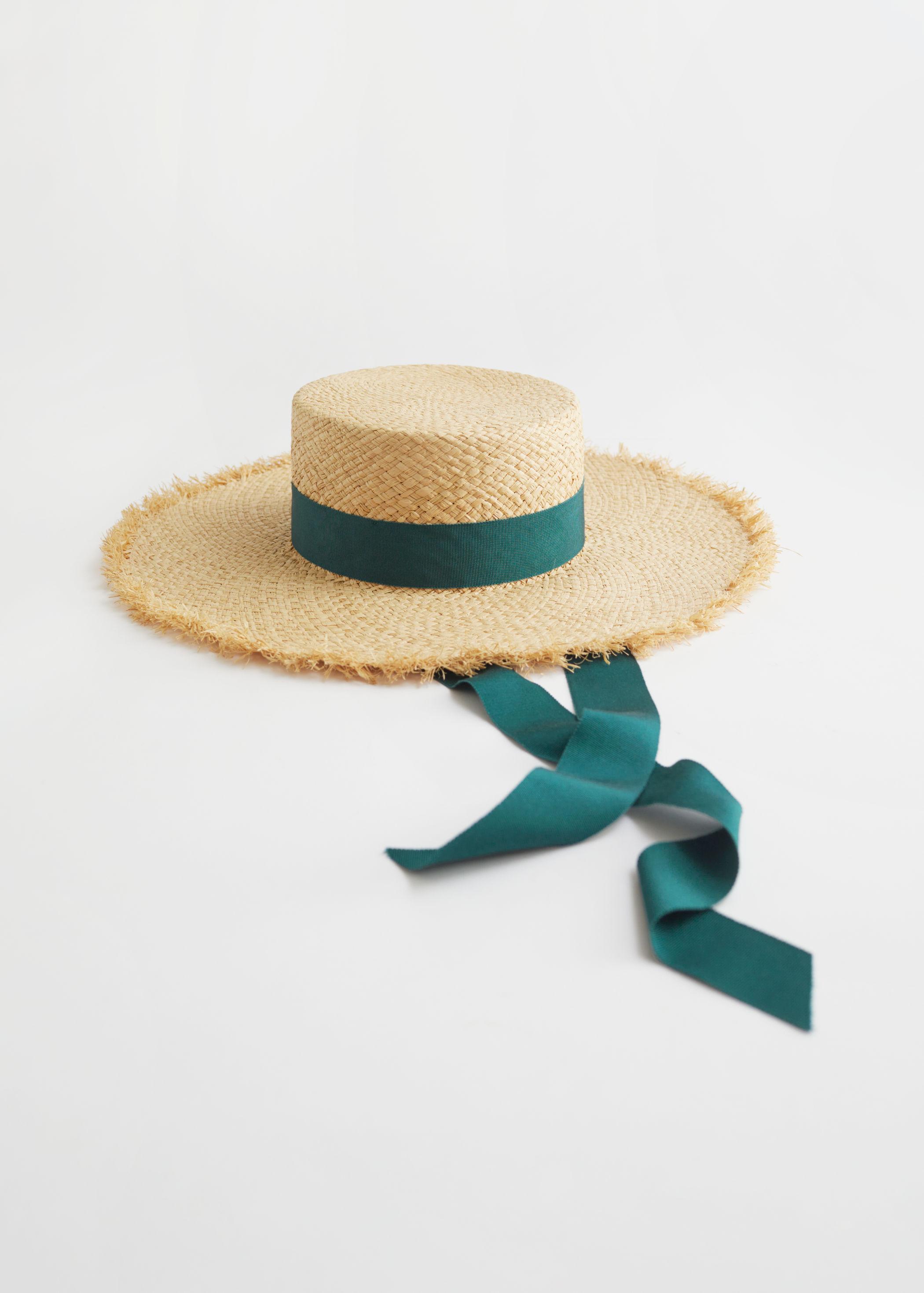 Hatt med grønt bånd