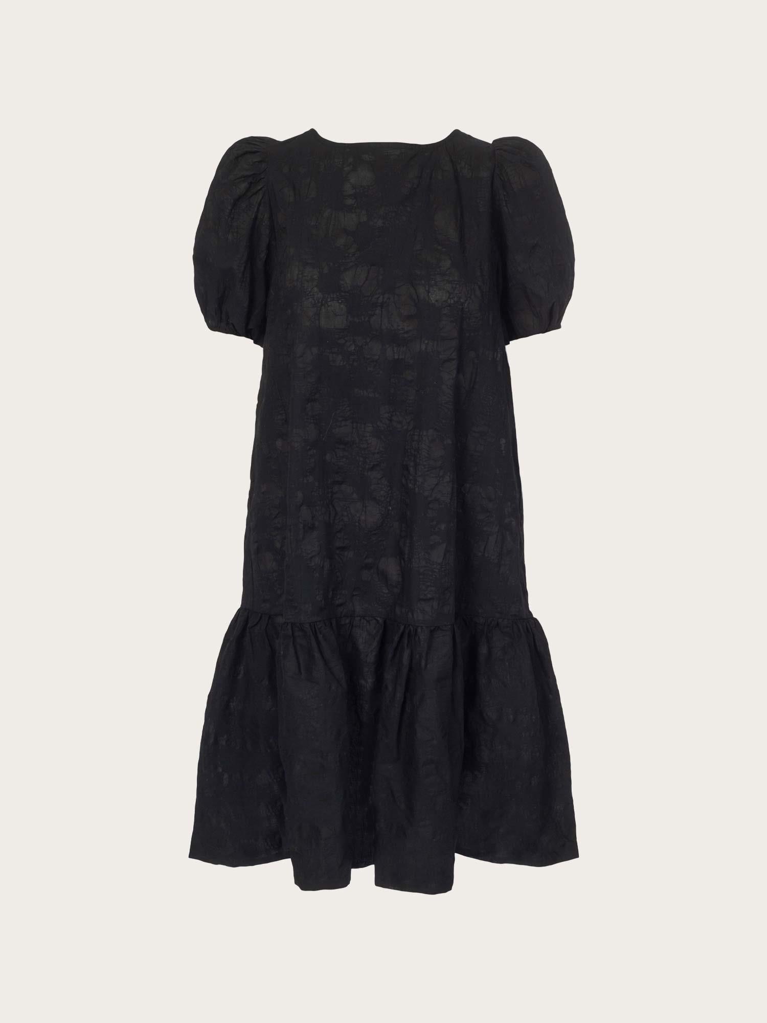 Svart kjole med knytedetaljer i ryggen