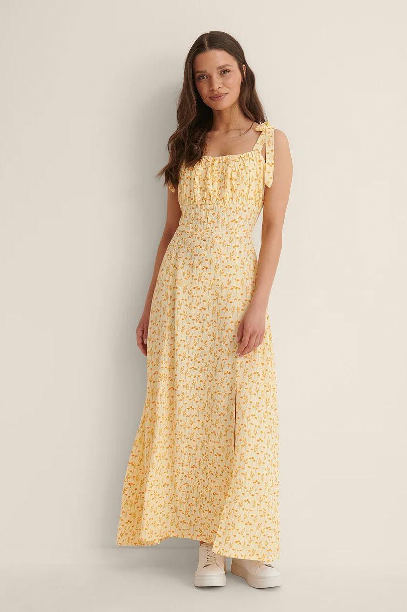 Gul kjole med knyting på skuldrene