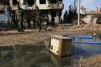 Tønnebomber har ødelagt beleiret syrisk by